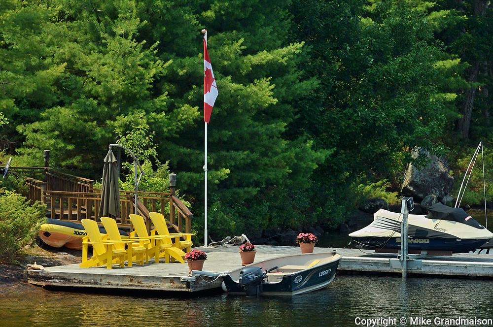 Muskoka chairds on dock<br />Muskoka Country<br />Ontario<br />Canada<br />Muskoka Country<br />Ontario<br />Canada