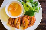 30 MARCH 2012 - HANOI, VIETNAM:   Crispy shrimp pancakes, called Banh Tom Ha Noi in Vietnamese, at Quan An Ngon restaurant in Hanoi, Vietnam.   PHOTO BY JACK KURTZ