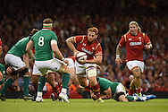 Dan Baker of Wales charges at opposite number Ireland's Jamie Heaslip (8). Wales v Ireland rugby union international, RWC warm up friendly match at the Millennium Stadium in Cardiff, South Wales on Saturday 8th August  2015.<br /> pic by Andrew Orchard, Andrew Orchard sports photography.