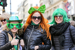 © Licensed to London News Pictures. 17/03/2019. London, UK. Women celebrate St Patrick's Day as the parade travels through the streets of central London. Photo credit: Dinendra Haria/LNP