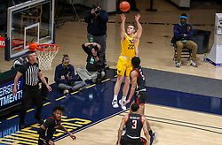 Jan 25, 2021; Morgantown, West Virginia, USA; West Virginia Mountaineers guard Sean McNeil (22) shoots a jumper along the baseline over Texas Tech Red Raiders guard Micah Peavy (5) during the first half at WVU Coliseum. Mandatory Credit: Ben Queen-USA TODAY Sports