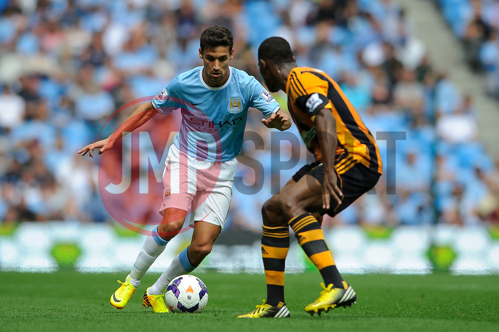 Man City Midfielder Jesus Navas is challenged by Hull Defender Maynor Figueroa (HON) during the first half of the match - Photo mandatory by-line: Rogan Thomson/JMP - Tel: Mobile: 07966 386802 31/08/2013 - SPORT - FOOTBALL - Etihad Stadium, Manchester - Manchester City v Hull City Tigers - Barclays Premier League.