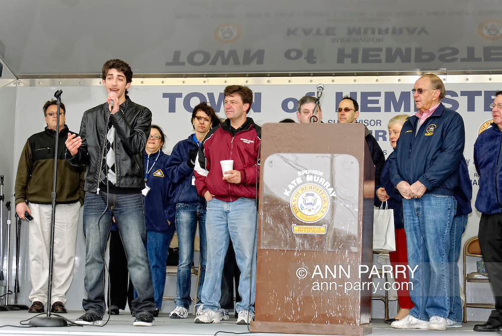 APRIL 16, 2011 - MERRICK, NY: Robbie Rosen, American Idol Season 10 contestant, singing on stage at his hometown's Merrick Kid Fest on Robbie Rosen Day presented by Merrick Chamber of Commerce, with to left of podium Nassau Legislator Dave Denenberg of Merrick, and right of podium Assemblyman Dave McDonough of Merrick, with Chamber of Commerce members, at Long Island, New York, USA.  (EDITORIAL USE ONLY)
