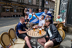 Pictured: Scotland fans in the capital were starting early for the England v Scotland game withan 8pm kick-off in London.  3pm is as good a time as any to get the beers in.<br /><br />Ger Harley | EEm Date
