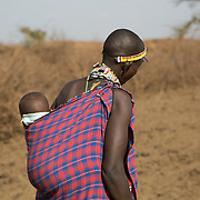 """Massai child being carried in the village outside of Amboseli, Kenya.<br /> <br /> For all details about sizes, paper and pricing starting at $85, click """"Add to Cart"""" below."""