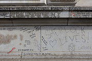 Graffiti scrawled on the exterior of Barts Hospital, by fans of the popular TV show Sherlock starring Benedict Cumberbatch where the fictional character was filmed, seemingly jumping to his death, on 5th March 2017, at Smithfield, in the City of London, England.