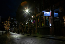 © Licensed to London News Pictures. 18/12/2020. Manchester, UK. Hospitality industries in Gay Village, Manchester sit quiet as the city remains in Tier 3. For many businesses this weekend before Christmas should be the busiest time of the year. Photo credit: Kerry Elsworth/LNP