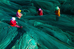 January 2, 2018 - Rongchen, Rongchen, China - Woman work on fishing nets. The Dongchu Island, a small fishing village located in Rongcheng, east China's Shandong Province, is regarded as one of the top ten most beautiful fishing village in China. (Credit Image: © SIPA Asia via ZUMA Wire)