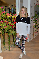 OLIVIA COX at the launch of the new Rimowa store at 153a New Bond Street, London on 29th June 2016.