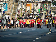16 DECEMBER 2015 - BANGKOK, THAILAND:  Members of an honor guard lead the funeral procession for Somdet Phra Nyanasamvara, who headed Thailand's order of Buddhist monks for more than two decades and was known as the Supreme Patriarch. The Patriarch died in 2013. He was ordained as a Buddhist monk in 1933 and appointed as the Supreme Patriarch in 1989. He was the spiritual advisor to Bhumibol Adulyadej, the King of Thailand when the King served as a monk in 1956. Tens of thousands of people lined the streets during the procession to pray for the Patriarch.    PHOTO BY JACK KURTZ