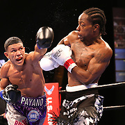 WINTER PARK, FL - AUGUST 02: Juan Carlos Payano (L) fights against Rau'shee Warren during the Premier Boxing Champions on Bounce TV boxing match at Full Sail University - Ebbs Auditorium on August 2, 2015 in Winter Park, Florida. Payano won the bout and retained his WBA and IBO  bantamweight title. (Photo by Alex Menendez/Getty Images) *** Local Caption *** Juan Carlos Payano; Rau'shee Warren