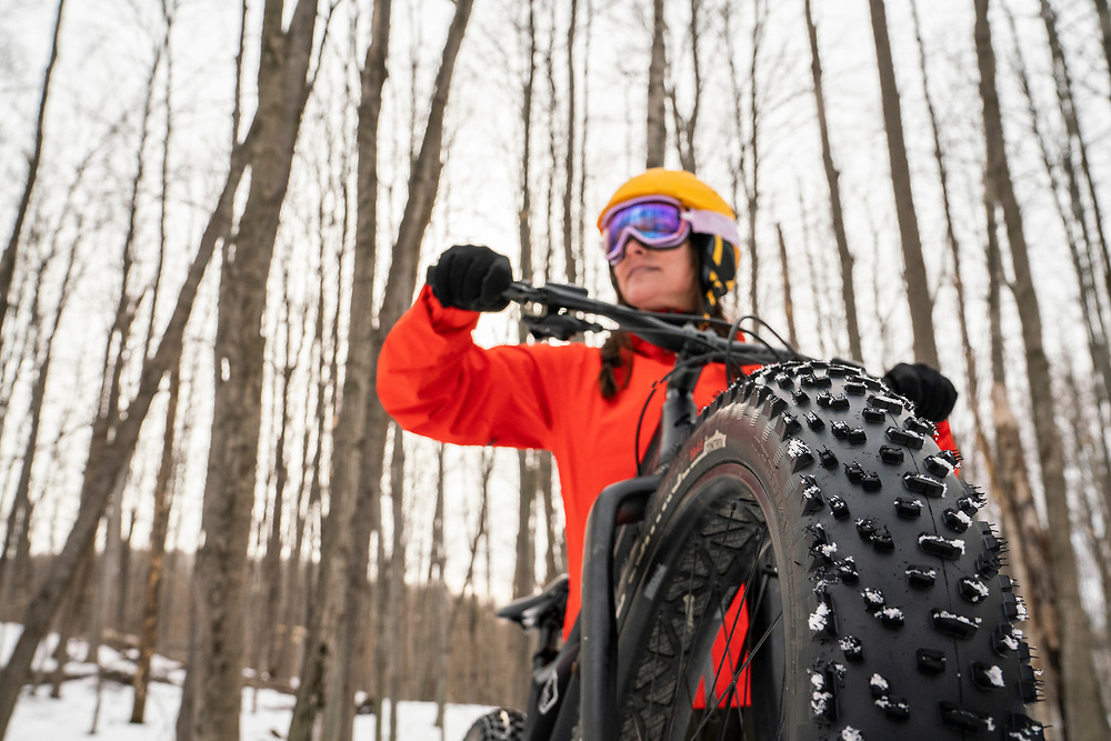 Fat biking on winter singletrack trails at Avalanche Mountain recreation area in Boyne City, Michigan.