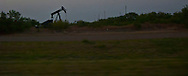 A petroleum pump jack works in in a panorama image near Vernon, in west Texas.