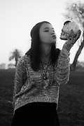 Young teen interacting with a skull Model releases