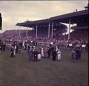 """30/06/1962 <br /> 06/30/1962<br /> 30 June 1962<br /> Irish Sweeps Derby at the Curragh Racecourse, Co. Kildare. general view of the  parade in front of the reserved enclosure for the Derby. The horses were shown and mounted on the course. leading three horses (r-l) are: """"Talgo Abbess"""", owned by T. Scahill; """"Sebring"""" owned by Townsend B. Martin and """"Le Pirate"""" owned by Major Victor McCalmont."""