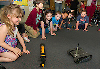 "Kindergarten students at Woodland Heights Elementary School learn about the ""Loog"" and the ""First Look"" robots from Jake Drouin with IRobot on Wednesday afternoon.  (Karen Bobotas/for the Laconia Daily Sun)"