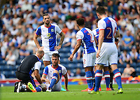 Blackburn Rovers' Elliott Ward receives treatment for an injury which forced him off during the first half<br /> <br /> Photographer Chris Vaughan/CameraSport<br /> <br /> Football - The EFL Sky Bet Championship - Blackburn Rovers v Norwich City - Saturday 6th August 2016 - Ewood Park - Blackburn<br /> <br /> World Copyright © 2016 CameraSport. All rights reserved. 43 Linden Ave. Countesthorpe. Leicester. England. LE8 5PG - Tel: +44 (0) 116 277 4147 - admin@camerasport.com - www.camerasport.com