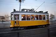 Lisbon's nº28 yellow tram on his way through the central, most historic region of the city.