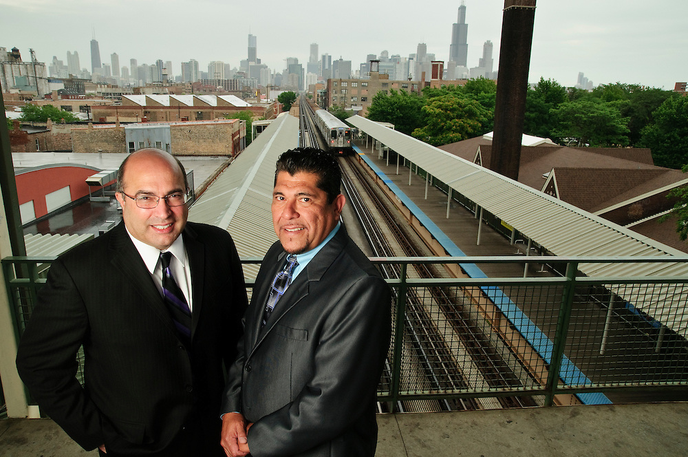 GSG Consulting CEO Guillermo Garcia and Parsons Brinckerhoff Senior Vice President and Central Division Regional Manager John Trotta (with glasses) are overseeing the Chicago Transit Authority (CTA) Red Line South Reconstruction Project. They are pictured at the CTA Green Line Ashland Station on Friday, July 26th, 2013 © 2013 ViaPhotos / Brian J. Morowczynski