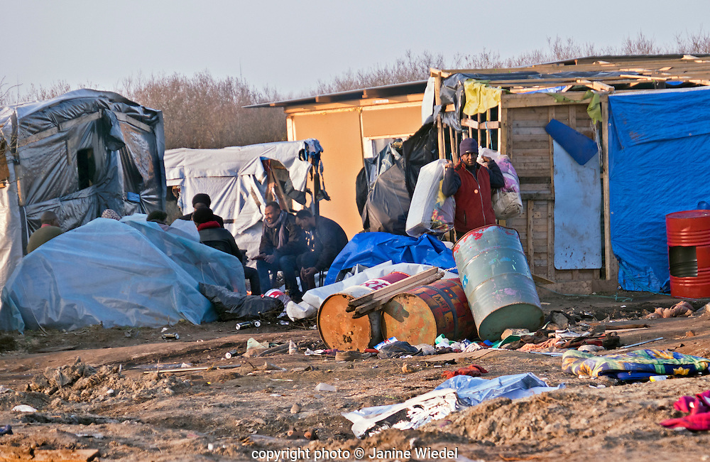 The Jungle refugee & migrant camp in Calais France where thousands of refugees have lived in muddy and squalid condition hoping to get to Britain.