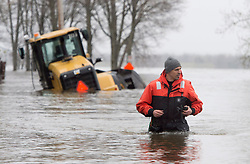 A member of the Canadian military makes his way through floodwaters near a submerged piece of heavy equipment, Monday, May 8, 2017 in Gatineau, Quebec, Canada. Photo by Adrian Wyld /The Canadian Press/ABACAPRESS.COM