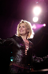 Kim Wilde steps out of the her TV Gardening clothes and Back on Stage to Tour with<br /><br />Steve Starnge (Visage)<br />Claire Grogan (Altered Images)<br />The Belle Stars<br />Dollar<br />Kim Wilde<br />The Human League<br />Play on the Here and Now  Christmas Party Tour at Sheffields Hallam FM Arena Friday 13th December 2002<br /><br />[#Beginning of Shooting Data Section]<br />Nikon D1 <br />2002/12/13 22:53:39.4<br />JPEG (8-bit) Fine<br />Image Size:  2000 x 1312<br />Color<br />Lens: 80-200mm f/2.8-2.8<br />Focal Length: 80mm<br />Exposure Mode: Manual<br />Metering Mode: Spot<br />1/200 sec - f/2.8<br />Exposure Comp.: 0 EV<br />Sensitivity: ISO 800<br />White Balance: Auto<br />AF Mode: AF-S<br />Tone Comp: Normal<br />Flash Sync Mode: Not Attached<br />Color Mode: <br />Hue Adjustment: <br />Sharpening: Normal<br />Noise Reduction: <br />Image Comment: <br />[#End of Shooting Data Section]