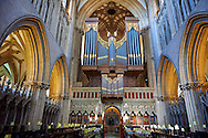 """Interior and organ of the the medieval Wells Cathedral built in the Early English Gothic style in 1175, Wells Somerset, England . Its Gothic architecture is mostly in Early English style of the late 12th – early 13th centuries. Building began about 1175 at the east end with the choir. Historian John Harvey sees it as Europe's first truly Gothic structure. Its Early English front with 300 sculpted figures, is seen as a """"supreme triumph of the combined plastic arts in England"""".<br /> <br /> Visit our MEDIEVAL PHOTO COLLECTIONS for more   photos  to download or buy as prints https://funkystock.photoshelter.com/gallery-collection/Medieval-Middle-Ages-Historic-Places-Arcaeological-Sites-Pictures-Images-of/C0000B5ZA54_WD0s"""