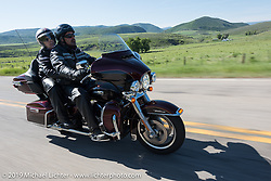 Gordon and Sherri Bridges of Lincoln, NE on their 2015 Ultra Glide riding from Steamboat Springs to Doc Holliday's Harley-Davidson in Glenwood Springs during the Rocky Mountain Regional HOG Rally, Colorado, USA. Thursday June 8, 2017. Photography ©2017 Michael Lichter.