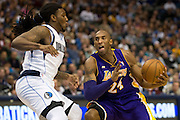 Kobe Bryant (24) of the Los Angeles Lakers drives to the basket against Jae Crowder (9) of the Dallas Mavericks at the American Airlines Center in Dallas on Sunday, February 24, 2013. (Cooper Neill/The Dallas Morning News)