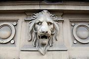 Lionhead on a building in Bucharest, Romania