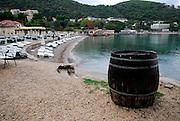 View of beach, large barrel in forgeground. Lapad, Dubrovnik, Croatia