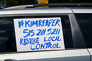 """24 JULY 2020 - DES MOINES, IOWA: A sign on the side of a teacher's car in the motorcade around the Iowa State Capitol. Hundreds of teachers from across Iowa came to the state capitol Friday to protest Governor Kim Reynolds' order that school must reopen with in person education and minimized the potential for """"distance learning."""" The event was one of the largest COVID-19 protests in Iowa since the pandemic started, more than 740 teachers signed up to attend the protest. After the protest officially ended, many teachers left the capitol and drove to Gov. Reynolds' residence, where they drove around her mansion and honked horns. Some people left notes on the entrance to the governor's residence. Gov. Reynolds ordered the school reopening last week, but according to teachers, the state has not implemented health guidelines or bought protective equipment like face masks in the quantity required to slow the spread of the Coronavirus (SARS-CoV-2). Iowa's numbers of COVID-19 infections are up statewide.         PHOTO BY JACK KURTZ"""