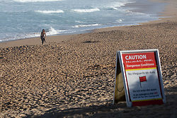© Licensed to London News Pictures. 26/05/2020. Padstow, UK. A water safety advice sign is seen on Constantine Bay, Cornwall, after a man died after getting into difficulty in the sea between Constantine Bay and neighbouring Treyarnon Bay. A teenage girl also died after being trapped in a capsized rigid inflatable boat near Padstow. There were multiple other beach related incidents reported to emergency services over the bank holiday. Due to Coronavirus (COVID-19), the RNLI are currently not operating a Lifeguard service on the beaches in Cornwall, as there would be normally at this time of year. Photo credit : Tom Nicholson/LNP
