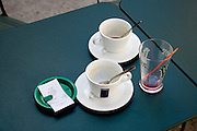 cups and bill on an outdoor restaurant table