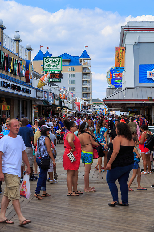 Ocean City, MD - July 10, 2016: Many people enjoying the boardwalk in Ocean City Maryland, during a warm summer day.