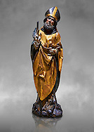 Gothic wooden statue of Sant Nicolau (Nicholas) from Gremany, circa 1500, tempera and gold leaf on wood, from the church of San Miguel de Medina del Campo, Valladolid..  National Museum of Catalan Art, Barcelona, Spain, inv no: MNAC  65507. Against a grey art background. .<br /> <br /> If you prefer you can also buy from our ALAMY PHOTO LIBRARY  Collection visit : https://www.alamy.com/portfolio/paul-williams-funkystock/gothic-art-antiquities.html  Type -     MANAC    - into the LOWER SEARCH WITHIN GALLERY box. Refine search by adding background colour, place, museum etc<br /> <br /> Visit our MEDIEVAL GOTHIC ART PHOTO COLLECTIONS for more   photos  to download or buy as prints https://funkystock.photoshelter.com/gallery-collection/Medieval-Gothic-Art-Antiquities-Historic-Sites-Pictures-Images-of/C0000gZ8POl_DCqE