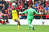 Burton Albion midfielder Lloyd Dyer (11) has a good chance but collides with Nottingham Forest goalkeeper Jordan Smith during the EFL Sky Bet Championship match between Nottingham Forest and Burton Albion at the City Ground, Nottingham, England on 21 October 2017. Photo by John Potts.