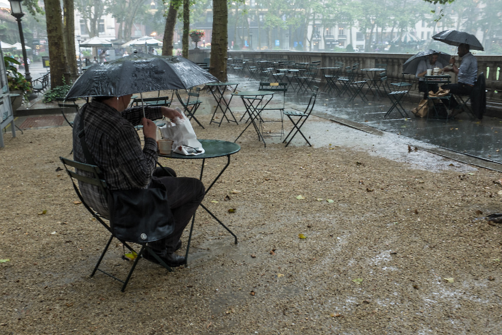 Lunch under an umbrella on a rainy summer day in Bryant Park.