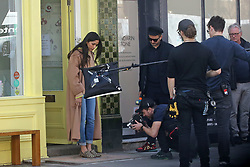 EXCLUSIVE: Freida Pinto appeared to have the time of her life on the second day of shooting scenes in Primrose Hill. The Indian actress, 34, looked absolutely stunning in tight jeans, a camel coloured coat, and leopard print shoes as crew shot her in front of the popular Primrose Hill Bakery famous for their delicious cupcakes, so delicious the actress helped herself to one. 30 Mar 2019 Pictured: Freida Pinto. Photo credit: MEGA TheMegaAgency.com +1 888 505 6342