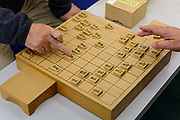 Playing shogi. Tendo City Shogi Club, Tendo, Yamagata Prefecture, Japan, February 20, 2018. The city of Tendo in Yamagata Prefecture is famous for its shogi (Japanese chess) playing pieces. Production started early in the 19th century and Tendo still produces over 95% of the Shogi pieces made in Japan.