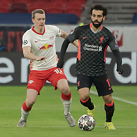 Lukas Klostermann (L) of RB Leipzig and Mohamed Salah (R) of Liverpool FC fight for the ball during the UEFA Champions League Round of 16 First Leg Football match between RB Leipzig and Liverpool FC in Budapest, Hungary on Feb. 16, 2021. ATTILA VOLGYI