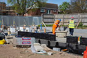 Builders laying foundations on new house construction site in Norwich. Norfolk.  United Kingdom.