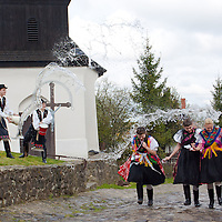 "Girls run as boys throw water at them as part of traditional Easter celebrations, during a media presentation in Holloko, 100 km (62 miles) east of Budapest, Hungary on April 14, 2011..Locals from the World Heritage village of Holloko, celebrate Easter with the traditional ""watering of the girls"", a Hungarian tribal fertility ritual rooted in the area's pre-Christian past. ATTILA VOLGYI"