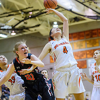 Gallup Bengal Journey Gilson (4) and Grants Pirate Kaylee Morris (21) compete for a rebound Friday at Gallup High School.