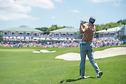 Jordan Spieth watches his approach on the 18th hole during the final round of the AT&T Byron Nelson in Las Colinas, Texas on May 31, 2015. (Cooper Neill for The New York Times)