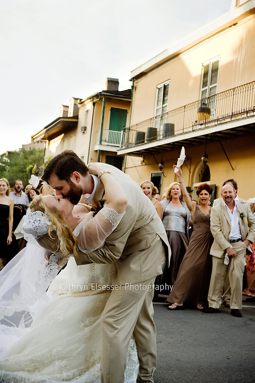 Bride and Groom passionate kiss at New Orleans style wedding on Bourbon Street in the French Quarter
