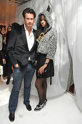 Designer PERCY PARKER and JOY VIELI at a party hosted by PPQ of Mayfair at the Fiat Flagship Store, 105 Wigmore Street, London W1 on 11th February 2008.<br />