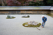 Monk raking Zen Garden