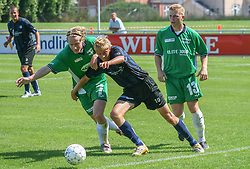 FODBOLD: Niels Peter Kjølbye (NKF) i kamp med Christian Pind og Jonas Rohrberg (Helsingør) under kampen i Kvalifikationsrækken, pulje 1, mellem Elite 3000 Helsingør og Nivå-Kokkedal FK den 6. august 2006 på Helsingør Stadion. Foto: Claus Birch