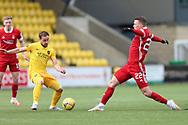 Aberdeen's Florian Kamberi (22) and Scott Pittman (8) of Livingston) during the Scottish Premiership match between Livingston and Aberdeen at Tony Macaroni Arena, Livingstone, Scotland on 1 May 2021.